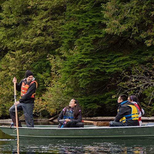 Students paddling a boat