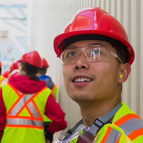 Marc looking up during a chemical plant tour
